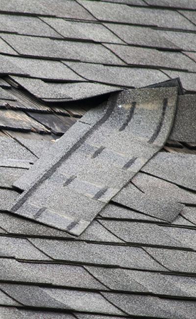 Broken roof shingles